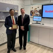 Mr. Diwakar Nigam, Newgen Managing Director and CEO, receives a special plaque from Mr. Don Lofstrom, President and General Manager, Alaris, a Kodak Alaris business